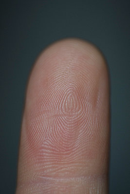 Close-up of finger against gray background - p301m1482405 by Halfdark