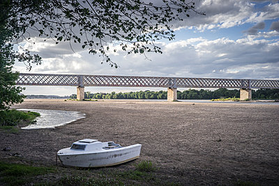 France, Boat on the beach - p1402m2191387 by Jerome Paressant