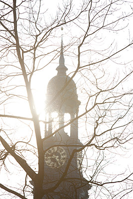 Steeple in backlight - p304m919176 by R. Wolf