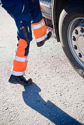 Reflective drivers trousers, close-up - p312m1084286f by Peter Hoelstad