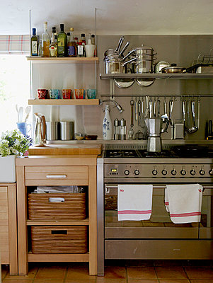 Stainless steel kitchen fittings and storage in 17th Century Oxfordshire house - p349m789615 by Brent Darby