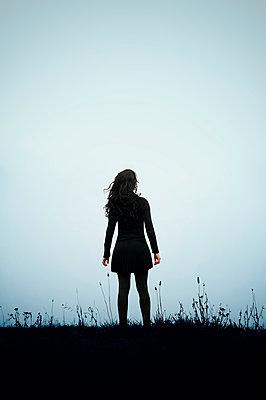 Woman in a meadow - p470m2082302 by Ingrid Michel