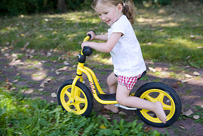 Girl with a training bike - p7810080 by Angela Franke