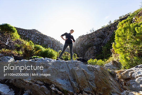 Teenage girl and younger brother hiking the Waterfall Trail, Stanford, South Africa. - p1100m2300926 by Mint Images