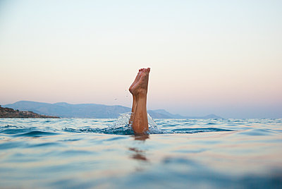 Feet in sea - p312m2174360 by Christian Ferm