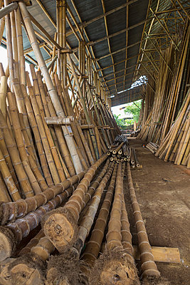 Bamboo trunks in factory, Ubud, Bali, Indonesia - p555m1419328 by Marc Romanelli
