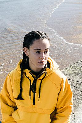 Portrait of teenage (16-17) girl in yellow coat - p924m2271231 by Armando Jesús Guevara