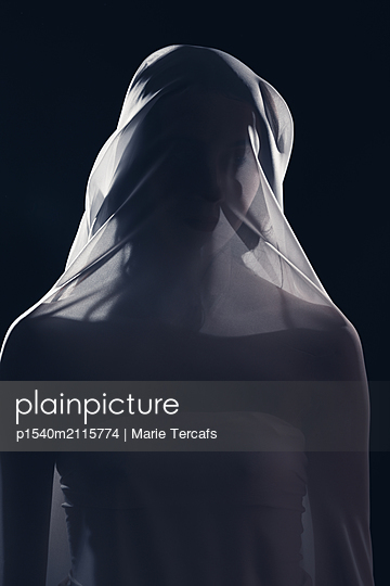 Woman covered by see through cloth  - p1540m2115774 by Marie Tercafs