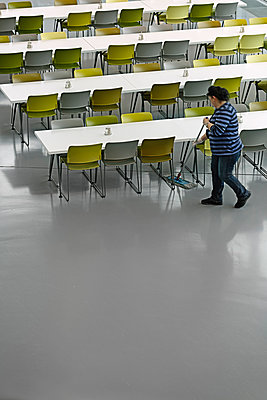 Cleaning lady working in canteen - p1292m1214324 by Niels Schubert