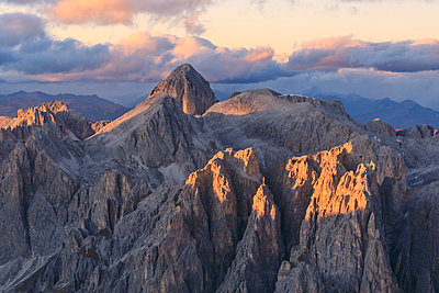 Aerial view of Catinaccio Group  at sunset, Dolomites, South Tyrol, Italy, Europe - p871m1533914 by Roberto Moiola