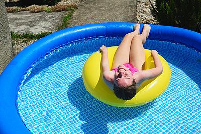 Girl in an inflatable pool - p1412m2044264 by Svetlana Shemeleva