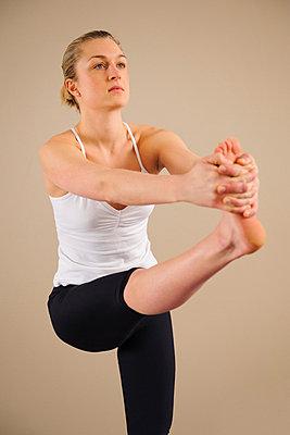 Woman doing yoga - p31227368f by Hans Berggren