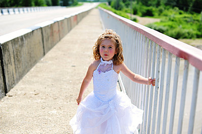 Portrait of a little girl in a festive dress during the wedding - p1412m2044273 by Svetlana Shemeleva
