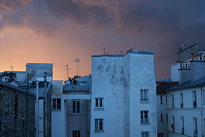 Roofs of Paris at sunset - p445m1452447 by Marie Docher