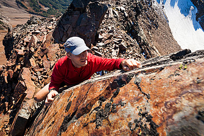 High angle view of hiker climbing rocky mountains - p1166m1474178 by Cavan Images