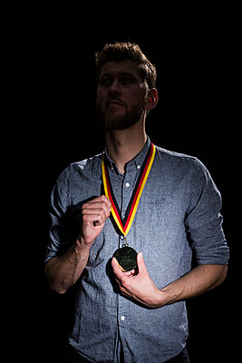 Man with prize medal - p341m2054103 by Mikesch