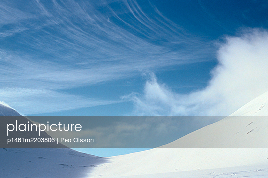 Cloud formation over snowy landscape, Sweden - p1481m2203806 by Peo Olsson