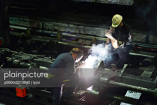 Welders doing maintenance works in a tube rolling mill - p300m2213840 by lyzs