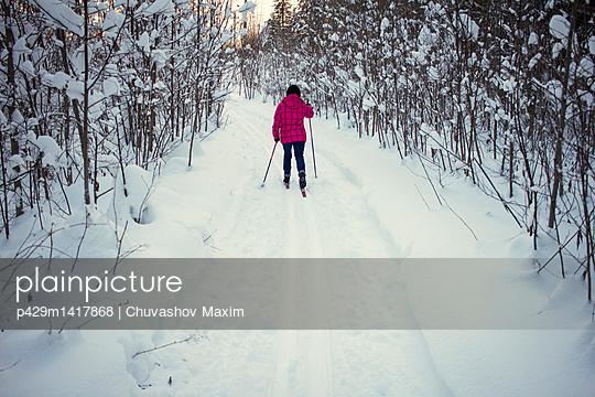 Teenage girl, cross country skiing, rear view, Chusovo, Russia