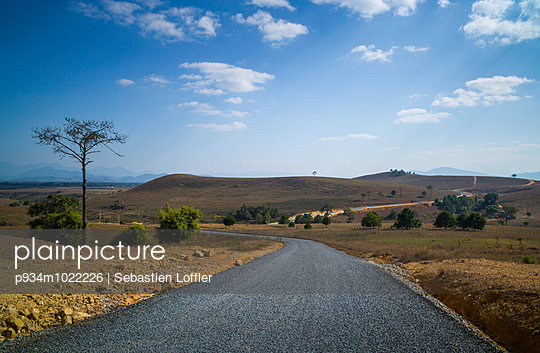Windy road leading to the Plain of Jars - Phu Keng Jars Quarry Site - p934m1022226 by Sebastien Loffler