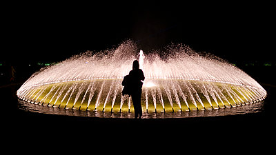 Fountain with light show in the night - p1600m2215253 by Ole Spata