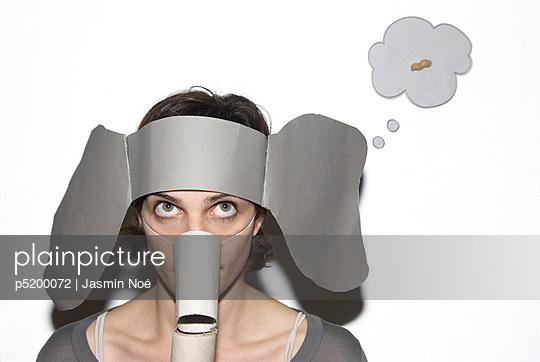 Woman wearing elephant mask - p5200072 by Jasmin Noé
