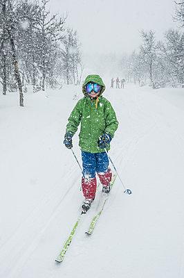 Child snowshoeing in forest - p312m1228833 by Fredrik Schlyter