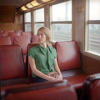 A woman in the Paris metro - p1610m2231174 by myriam tirler