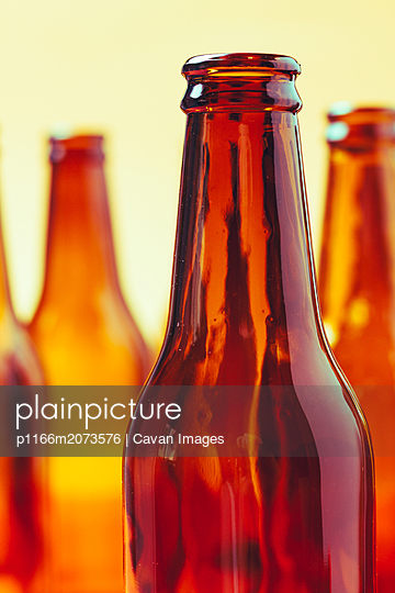 empty and brown glass bottles - p1166m2073576 by Cavan Images