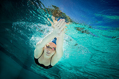 Young female swimmer during training - p1554m2272596 by Tina Gutierrez