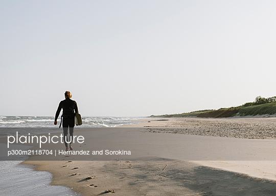 Surfer walking at the beach - p300m2118704 by Hernandez and Sorokina