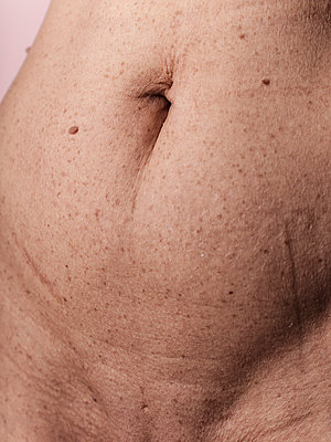Belly and pubic area of a woman - p1383m2167953 by Wolfgang Steiner