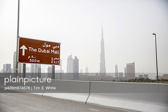 Dubai skyline viewed from highway, Dubai, UAE - p429m974578 by Tim E White