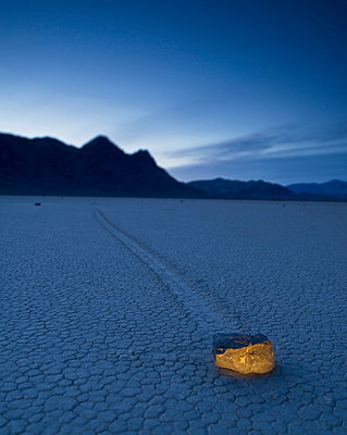 A Rock Formation Glowing On The Arid Ground In The Mojave Desert; Death Valley California United States Of America - p44213556f by David DuChemin