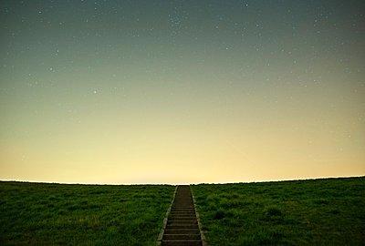 Stars above dike, Rilland, Zeeland, Netherlands - p429m1029700 by Mischa Keijser