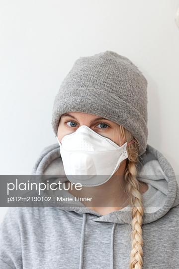 Woman wearing protective mask - p312m2190102 by Marie Linnér