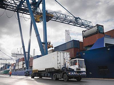 Lorry Working In A Port - p4296832f by Monty Rakusen