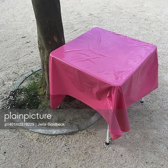 Table with pink coloured wax table-cloth - p1401m2278229 by Jens Goldbeck
