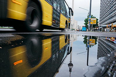 Germany, Berlin, Berlin TV Tower reflecting in puddle after rain - p300m1469668 by Michael Zwahlen