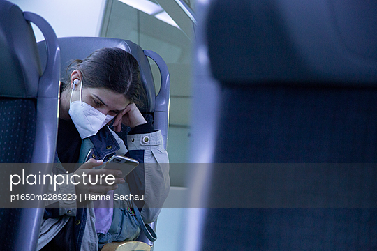 Young woman using smartphone in the train - p1650m2285229 by Hanna Sachau
