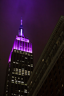 The Empire State Building lit up at night  - p1057m1466859 by Stephen Shepherd
