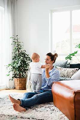 Mother playing with baby boy - p312m2052682 by Anna Johnsson