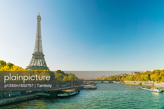 Eifel tower with Seine river on the foreground early in the morning  - p1332m1502757 by Tamboly