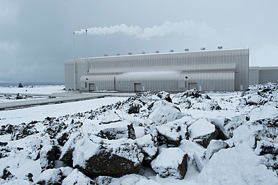 Power plant in snowy landscape - p555m1415713 by Pete Saloutos