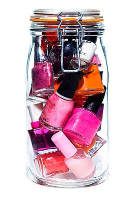 Nail polish in a jar - p9249077f by Image Source