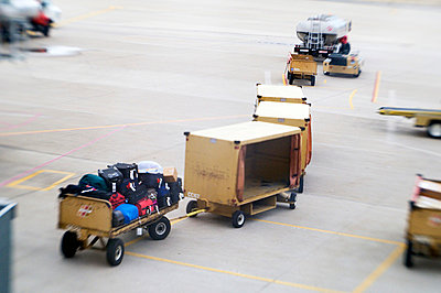 Airport baggage cart on tarmac - p3720406 by James Godman