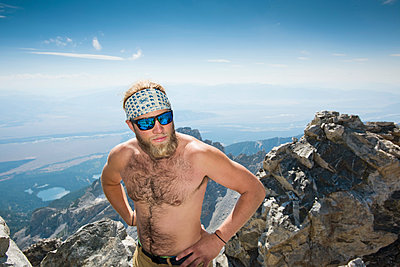 Close-up Of Shirtless Man On Top Of Rocky Mountain In Grand Teton National Park - p343m1217859 by Rob Hammer