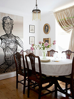 Dining room table and chairs with sculptural artwork 18th Century Georgian terrace - p349m789948 by Brent Darby