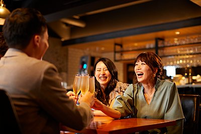 Young Japanese friends having fun together - p307m2135310 by Yosuke Tanaka