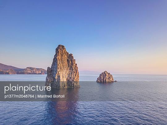 Italy, Sicily, Messina district, Mediterranean sea, Tyrrhenian sea, Aeolian islands, Lipari, Faraglioni the famous stack rocks in the sea of Lipari - p1377m2048764 by Manfred Bortoli